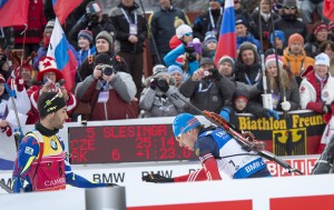 Martin Fourcade who won the mens 10 km sprint, reaches to shake hands with Anton Shipulin, who was in second at the finish line as fans look on at the Canmore IBU World Cup on Feb. 4. photo by Pam Doyle